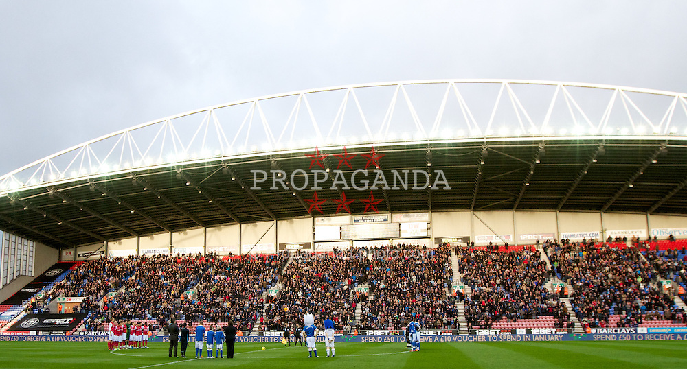 WIGAN, ENGLAND - Saturday, December 3, 2011: Arsenal and Wigan Athletic stand still for one minute to show their respect of the death of Wales manager Gary Speed before the Premiership match at the DW Stadium. (Pic by Vegard Grott/Propaganda)