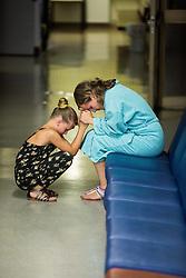 Ill women with her child praying in hospital, on August 15, 2016 in UKC Ljubljana, Ljubljana, Slovenia. Photo by Vid Ponikvar / Sportida
