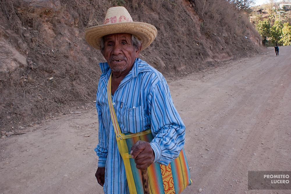 An elder man walks on the road in Juanacatlán, Guerrero on April 16th, 2010.  (Photo: Prometeo Lucero)