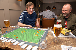 Edinburgh football fan and game designer Colin Webster has designed a brand-new football strategy game called Counter Attack. Last night he hosted a game session in Leith to demonstrate the game to a few interested players. The game is currently on the crowd-funding site Kickstarter and on track to meet it's funding target. If so, Colin hopes the gamne will be available by August this year. Pictured: A game in progress<br /> <br /> <br /> &copy; Jon Davey/ EEm