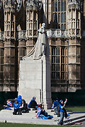 On the day that Prime Minister Theresa May returns to Brussels to negotiate an expected Brexit delay, pro-EU remainers protest beneath the statue of King George V outside Westminster Abbey opposite parliament in Westminster, in London, England.
