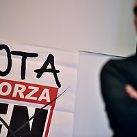 Como, Italy - 9 December 2017: A militant of Italy's neo-fascist Forza Nuova movement, listen to Roberto Fiore's speech during a press conference. Italy's Democrats led a rally at the same time a few hundreds meters away to warn about a comeback of fascist movements in the country.
