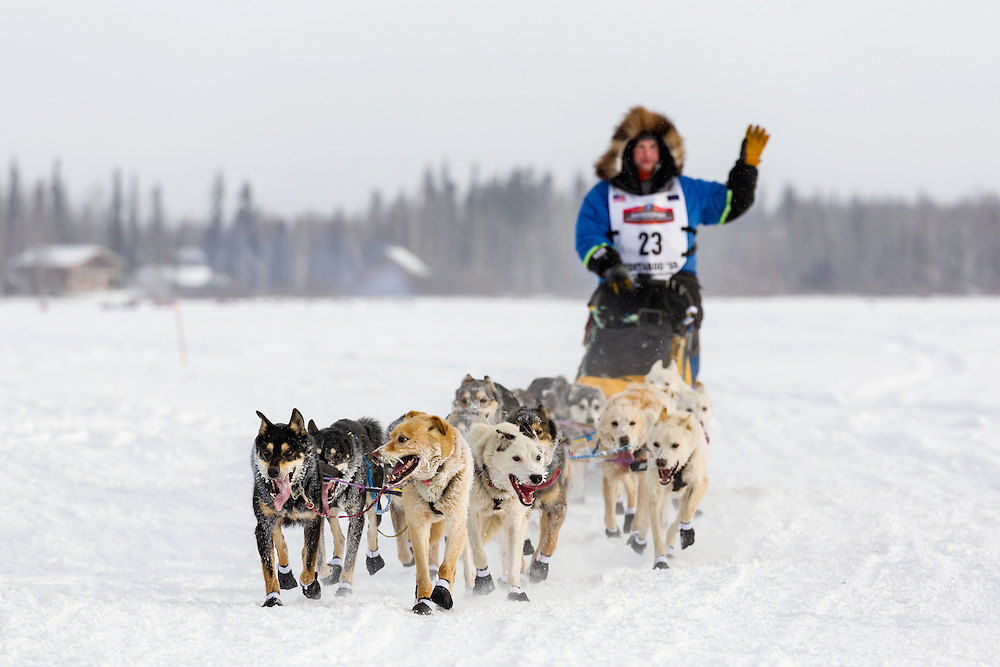 Musher Seth Barnes competing in the 43rd Iditarod Trail Sled Dog Race on the Chena River after leaving the restart in Fairbanks in Interior Alaska.  Morning.  Winter.