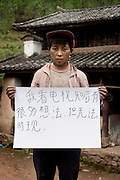 Luo Zheng Chui - 30 Yrs.<br /> Farmer.<br /> Yunnan Province.<br /> <br /> 'After watching television I have many thoughts, but I know I cannot achieve them'.
