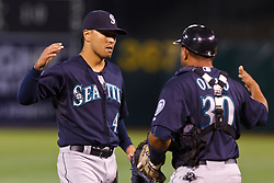OAKLAND, CA - APRIL 07: Brandon League #43 of the Seattle Mariners celebrates with Miguel Olivo #30 after the game against the Oakland Athletics at O.co Coliseum on April 7, 2012 in Oakland, California. The Seattle Mariners defeated the Oakland Athletics 8-7. (Photo by Jason O. Watson/Getty Images) *** Local Caption *** Brandon League; Miguel Olivo