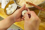 China, Hong Kong S.A.R..Nanxiang Steamed Bun - Causeway Bay. The chefs at the kitchen..Making of Nanxiang Steamed Buns.