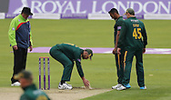 Nottinghamshire Outlaws place sawdust after Ajmal Shahzad (2nd from right) slipped while bowling during the Royal London One Day Cup match at Emirates Durham ICG, Chester-le-Street<br /> Picture by Simon Moore/Focus Images Ltd 07807 671782<br /> 06/09/2014