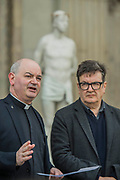 """Mark Wallinger with Canon Oakley - Kate Allen Director of Amnesty International UK, helped by Canon Mark Oakley (Chancellor of St Paul's Cathedral), installs Mark Wallinger's 'Ecce Homo' statue at St Paul's Cathedral. The life-size sculpture shows the figure of Jesus Christ and was the first artwork to be shown on Trafalgar Square's fourth plinth in 1999.Mark Wallinger, who won the Turner Prize in 2007, said: """"This vulnerable figure will stand at the top of the steps outside the entrance to St Paul's Cathedral as we approach Easter to highlight the plight of people around the world who are imprisoned and whose lives are threatened for speaking the truth, and for what they believe."""""""