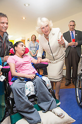 In the image - The Duchess meeting Neelu Patel.<br /> HRH The Duchess of Cornwall, Patron of Helen & Douglas House Hospice visits Douglas House to celebrate their 10th Anniversary. The Hospice cares for children and young adults with life shortening conditions, United Kingdom, Friday, 9th May 2014. Picture by i-Images