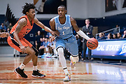 San Diego Toreros guard Braun Hartfield (1) drives against Cal State Fullerton Titans guard Wayne Arnold (11) during an NCAA basketball game, Wednesday, Dec. 11, 2019, in Fullerton, Calif. San Diego defeated CSUF 66-54. (Jon Endow/Image of Sport)