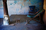 Sabapathy House. Vaddukodai, Jaffna.<br /> Deck chair and foot stool. Inner courtyard of a Jaffna home. The short pillar is typical of an older square courtyard home on the peninsula. 2011