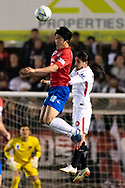 Bonnyrigg White Eagles midfielder Mun-Soo Gil (18) and Western Sydney Wanderers defender Raul Llorente (24) go up for the ball at the FFA Cup Round 16 soccer match between Bonnyrigg White Eagles FC v Western Sydney Wanderers FC at Marconi Stadium in Sydney.