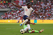 Nigeria William Troost-Ekong (5) tackling England Danny Welbeck (21), chance during the Friendly International match between England and Nigeria at Wembley Stadium, London, England on 2 June 2018. Picture by Matthew Redman.