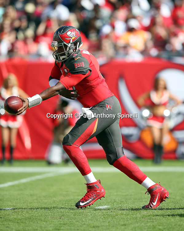 Tampa Bay Buccaneers quarterback Jameis Winston (3) hands off the ball on a running play during the 2015 week 14 regular season NFL football game against the New Orleans Saints on Sunday, Dec. 13, 2015 in Tampa, Fla. The Saints won the game 24-17. (©Paul Anthony Spinelli)