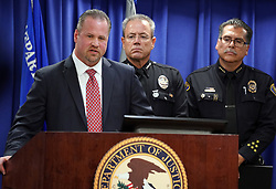 April 29, 2019 - Los Angeles, California, U.S. - FBI Special Agent RYAN YOUNG, left, talks about the arrest of Mark Steven Domingo during a press conference at the U.S. Attorney's office in Los Angeles on Monday. LAPD Chief MICHEL MOORE, center, and Long Beach Police Chief ROBERT LUNA, right, listen in. On Friday, FBI agents arrested Domingo, 26, of Reseda on federal charges in a terrorist plot to detonate a bomb at a Long Beach rally over the weekend. (Credit Image: © Scott Varley/SCNG via ZUMA Wire)