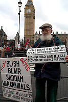 Man protesting in Parliament Square London asking government to end occupation of Iraq and not to invade Iran March 2006.