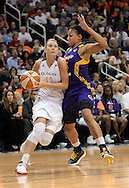 Sep 21, 2013; Phoenix, AZ, USA; Phoenix Mercury forward Penny Taylor (13) drives the ball against the Los Angeles Sparks guard Marissa Coleman (25) in the first half during Game 2 of a WNBA basketball Western Conference semifinal series at US Airways Center. Mandatory Credit: Jennifer Stewart-USA TODAY Sports
