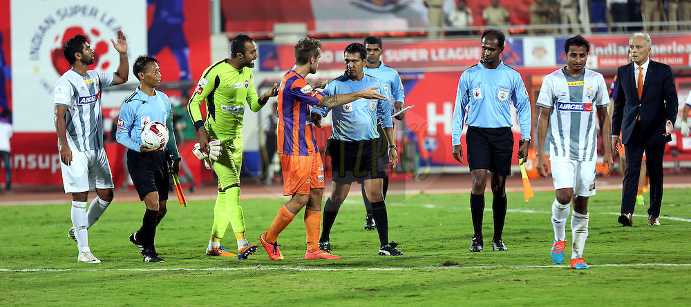 Arindam Bhattacharya of FC Pune City and Davide Colomba of FC Pune City speaks with the officials during match 44 of the Hero Indian Super League between FC Pune City and Atletico de Kolkata FC held at the Shree Shiv Chhatrapati Sports Complex Stadium, Pune, India on the 29th November 2014.<br /> <br /> Photo by:  Sandeep Shetty/ ISL/ SPORTZPICS