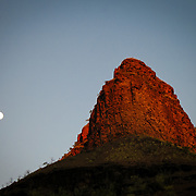 Rock precipice and moon rise, Leopold Mountain Range, the Kimberly, Australia. Photo by Jen Klewitz