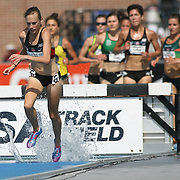 BUSH - 13USA, Des Moines, Ia. - Nicole Bush took control of the steeplechase half way through.  Photo by David Peterson