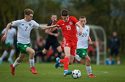 WREXHAM, WALES - Wednesday, October 30, 2019: Wales' Joel Cotterill (C) gets away from Republic of Ireland's Cian Kelly during the 2019 Victory Shield match between Wales and Republic of Ireland at Colliers Park. (Pic by David Rawcliffe/Propaganda)