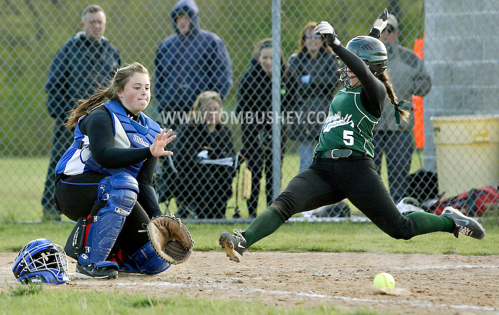 Cornwall's Megan Staudle slides home as Goshen catcher Shannon Cole waits for the throw during a game in Cornwall on Friday, April 27, 2012.
