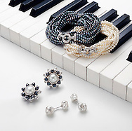 Night and Day suite of matching black and white pearl bracelets and earrings shown with pearl and diamond cuff links