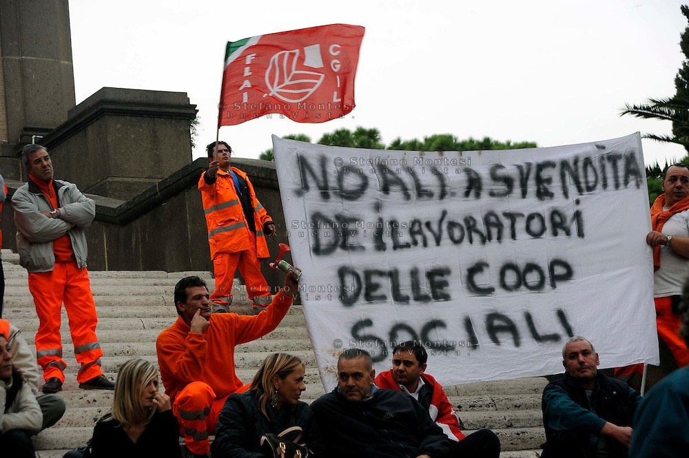 Roma, 05 Novembre 2009.Manifestazione di lavoratori delle cooperative sociali in Campidoglio.Manifestation of workers in social cooperatives in the Capitol.The banner reads: .No to the sell-off of workers in social coop