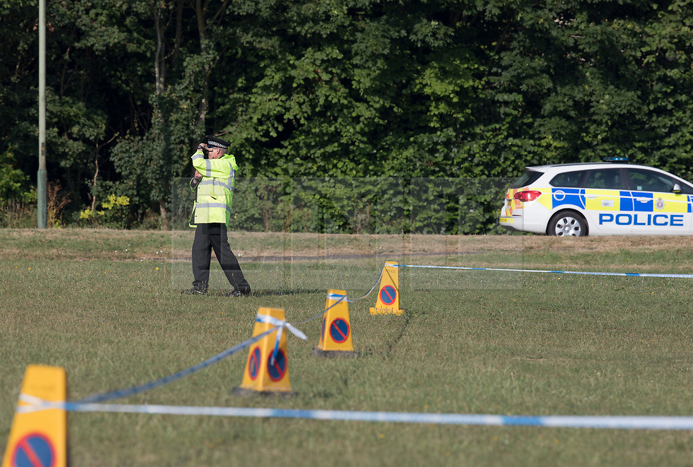 © Licensed to London News Pictures. 04/07/2018. Amesbury, UK.  A police officer guards a cordoned off area on the village green at Raleigh Crescent in Amesbury where it is thought  Dawn Sturgess, 44, and her partner Charlie Rowley, 45, may have visited for a family fun day before they were taken ill on Saturday 30th June 2018. Police have confirmed that the couple have been in contact with Novichok nerve agent. Former Russian spy Sergei Skripal and his daughter Yulia were poisoned with Novichok nerve agent in nearby Salisbury in March 2018. Photo credit: Peter Macdiarmid/LNP