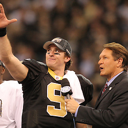 Jan 24, 2010; New Orleans, LA, USA; New Orleans Saints quarterback Drew Brees (9) talks to Fox broadcaster Chris Myers as running back Reggie Bush (left) looks on following a 31-28 overtime victory by the New Orleans Saints over the Minnesota Vikings in the 2010 NFC Championship game at the Louisiana Superdome. Mandatory Credit: Derick E. Hingle-US PRESSWIRE