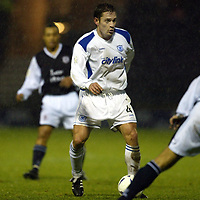 Raith Rovers v St Johnstone...29.11.03<br />Paul Bernard holds the ball up<br /><br />Picture by Graeme Hart.<br />Copyright Perthshire Picture Agency<br />Tel: 01738 623350  Mobile: 07990 594431