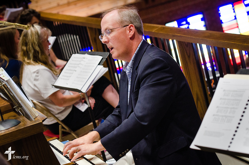 Jeffrey Blersch, professor of music at Concordia University, Nebraska, performs on the organ Monday, July 28, 2014, during the 2014 Institute on Liturgy, Preaching and Church Music at St. John Lutheran Church in Seward, Neb.