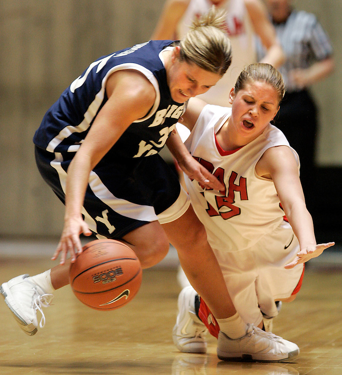 University of Utah's Morgan Warburton reaches in and tries to steal the ball but ends up fouling  BYU's Melinda Johnsen during game at the Huntsman Center on the U of U campus Saturday January 27, 2006 in Salt Lake City, Utah.  August Miller/ Deseret Morning News