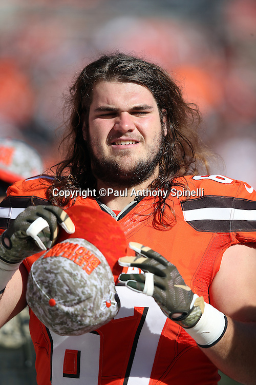 Cleveland Browns offensive tackle Austin Pasztor (67) looks on from the sideline during the 2015 week 8 regular season NFL football game against the Arizona Cardinals on Sunday, Nov. 1, 2015 in Cleveland. The Cardinals won the game 34-20. (©Paul Anthony Spinelli)