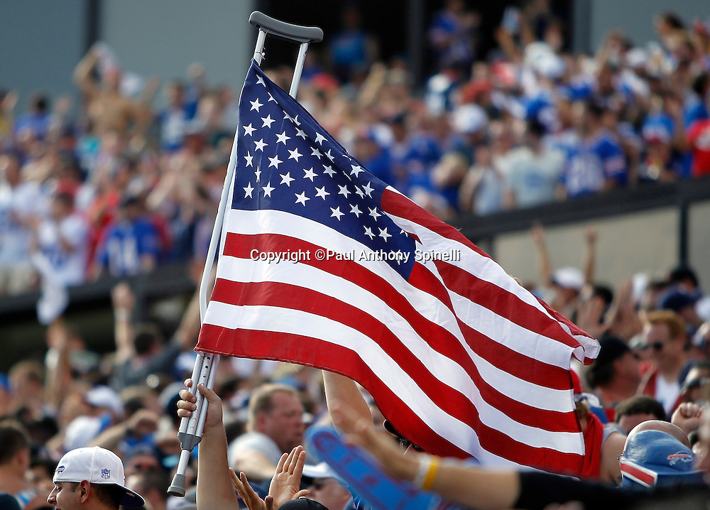 A Buffalo Bills fan waves an American flag attached to a leg crutch during the NFL week 3 football game against the New England Patriots on Sunday, September 25, 2011 in Orchard Park, New York. The Bills won the game 34-31. ©Paul Anthony Spinelli