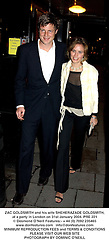 ZAC GOLDSMITH and his wife SHEHERAZADE GOLDSMITH, at a party in London on 31st January 2004.PRE 221