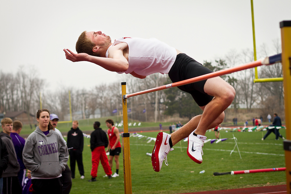 Griffin Lentsch '13 flops over the high jump bar during the Cornell College Open track meet last Saturday.
