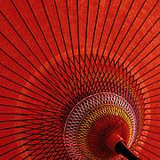 Japan, Toyama-ken, Toyama. April/09/2005...Detail of the red umbrella used in tea ceremonies performed outdoors.
