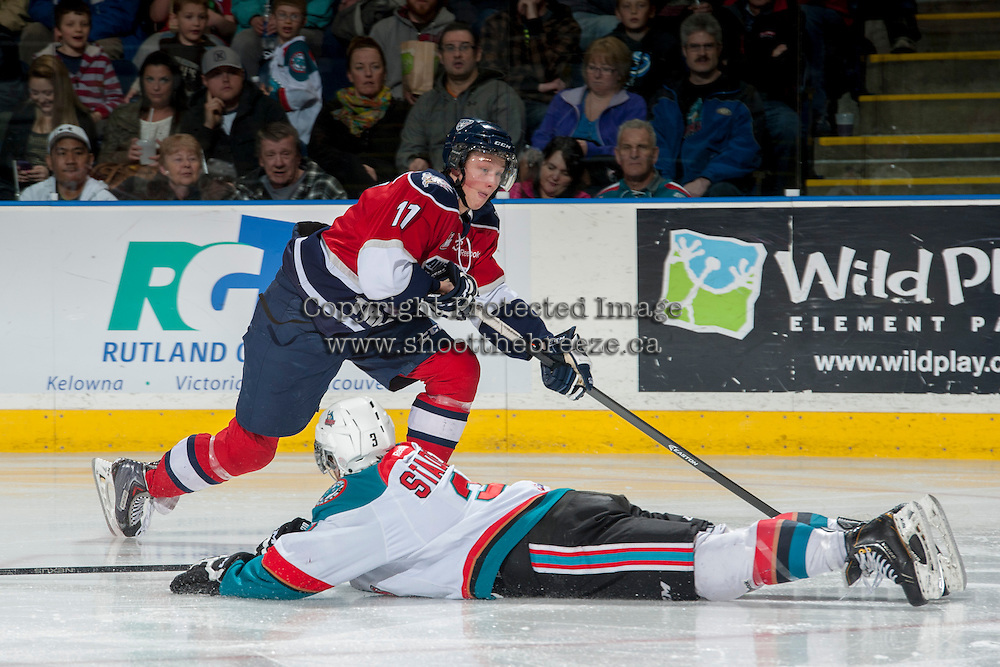 KELOWNA, CANADA - MARCH 8: Riley Stadel #3 of the Kelowna Rockets tries to block a shot from Ty Comrie #11 of the Tri City Americans during second period on March 8, 2014 at Prospera Place in Kelowna, British Columbia, Canada.   (Photo by Marissa Baecker/Getty Images)  *** Local Caption *** Ty Comrie; Riley Stadel;