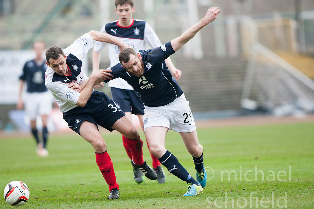 Falkirk's David McCracken and Dundee's Craig Beattie.<br /> half time : Dundee 0 v 1 Falkirk, Scottish Championship game played today at Dundee's Dens Park.<br /> &copy; Michael Schofield.