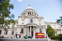 Figurines of London officers and public transports with St. Paul's Cathedral in background