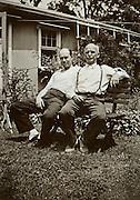 2 men relaxing outside in the garden 1939 America