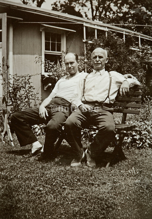 2 men relaxing outside in the garden 1939 America