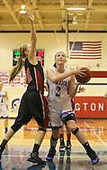 Washington Warrior's Abby Herb (2) eyes the basket as Linn-Mar Lion's Aryn Jones (21) defends during their Regional Semi-Final game at Washington High School in Cedar Rapids on Saturday, February 16 2013.
