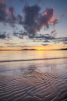 Sunset at Clayton Beach Larrabee State Park Washington. SanJuan Islands in the distance.