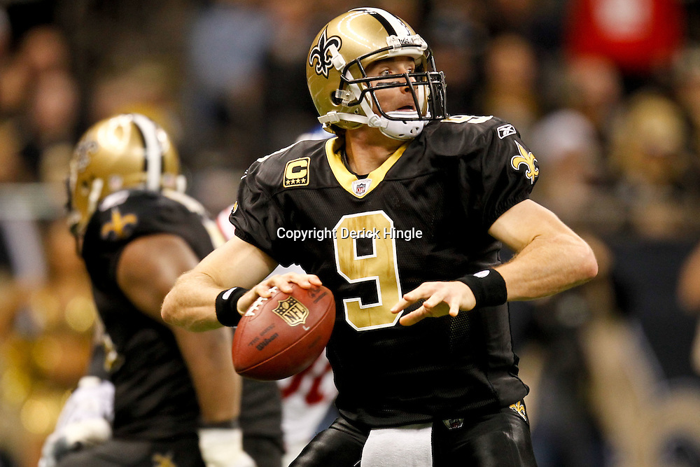 November 28, 2011; New Orleans, LA, USA; New Orleans Saints quarterback Drew Brees (9) against the New York Giants during the second quarter of a game at the Mercedes-Benz Superdome. The Saints defeated the Giants 49-24. Mandatory Credit: Derick E. Hingle-US PRESSWIRE