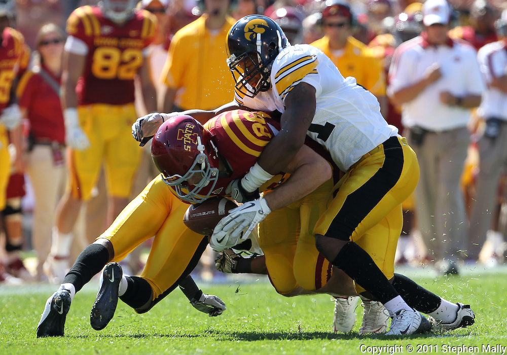 September 10, 2011: Iowa State Cyclones tight end Kurt Hammerschmidt (96) is hit by Iowa Hawkeyes linebacker Anthony Hitchens (31) after a catch during the first half of the game between the Iowa Hawkeyes and the Iowa State Cyclones during the Iowa Corn Growers Cy-Hawk game at Jack Trice Stadium in Ames, Iowa on Saturday, September 10, 2011. Iowa State defeated Iowa 44-41 in 3OT.