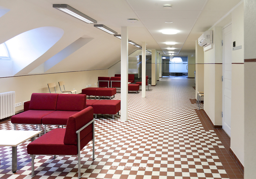 Corridor, seats with checked red and white floors in Tartu University, Estonia