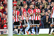 Brentford striker, Scott Hogan (9) celebrating scoring his second goal 3-0 during the Sky Bet Championship match between Brentford and Fulham at Griffin Park, London, England on 30 April 2016. Photo by Matthew Redman.
