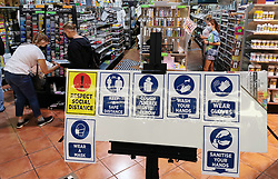 JOHANNESBURG, May 3, 2020  Customers with face masks shop at a stationery store in Johannesburg, South Africa, May 2, 2020..  South Africa on Saturday reported 385 new COVID-19 cases in the past 24 hours, the highest daily surge since the country recorded its first case in early March..  The newly-added cases brought the total number of the infection to 6,336, Health Minister Zweli Mkhize said in a statement..  The country has reported 123 virus-related deaths by Saturday, said the minister. (Credit Image: © Chen Cheng/Xinhua via ZUMA Wire)